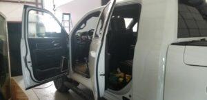 white truck getting window tinting