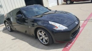 black nissan with window tinting