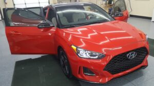 red Hyundai getting paint protection