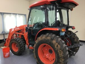 Kubota tractor with before paint and window protection