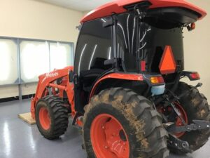 Kubota tractor with paint and window protection