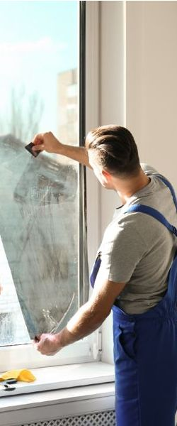 worker installing window tinting