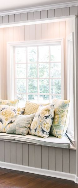 close up of windows with large sill and pillows