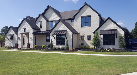 stone home with tinted windows