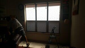 dark room with light shining through the window
